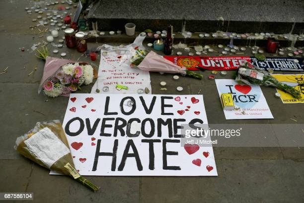 Members of the public pause to look at floral tributes and messages as the working day begins on May 24 2017 in Manchester England An explosion...