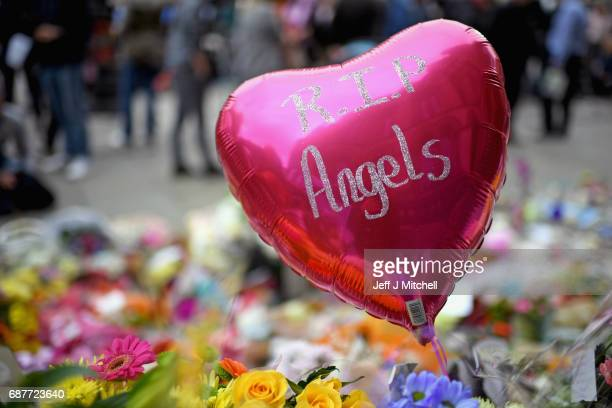 Members of the public pause to look at floral tributes and messages in St Anns Square on May 24 2017 in Manchester England An explosion occurred at...
