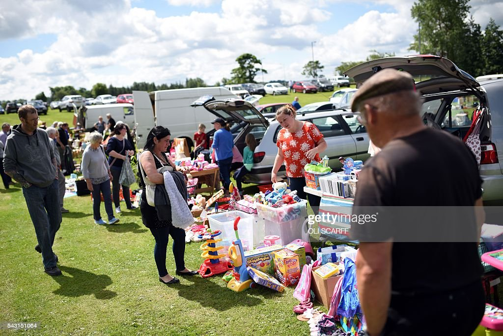 Members of the public peruse the stalls at a car boot sale in the village of St Boswells in Scotland close to the border between England and Scotland on June 26, 2016. Scotland's First Minister Nicola Sturgeon campaigned strongly for Britain to remain in the EU, but the vote to leave has given the Scottish National Party leader a fresh shot at securing independence. Sturgeon predicted more than a year ago that a British vote to leave the alliance would give pro-European Scots cause to hold a second referendum on breaking with the UK. SCARFF