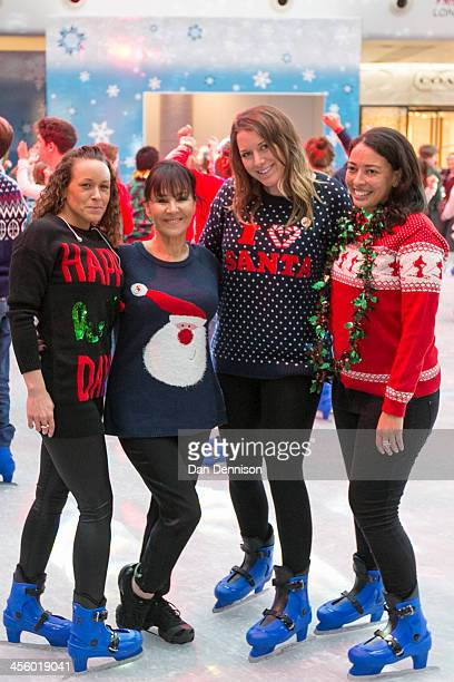 Members of the public pose with Arlene Philips after an attempt to break the world record for the most people wearing Christmas jumpers on December...