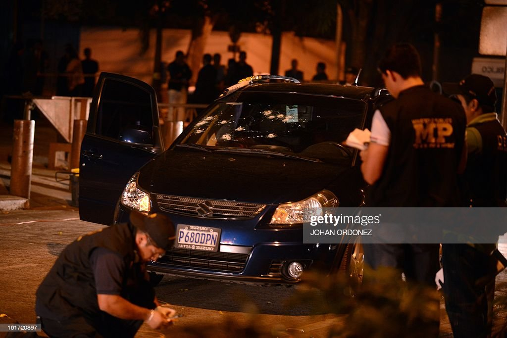 Members of the Public Prosecutor Office works at the crime scene where prominent Guatemalan lawyer Lea De Leon Marroquin was shot and killed by unidentified gunmen in Guatemala City on Febrary 14, 2013. De Leon Marroquin had received threats after handling high-profile cases.AFP PHOTO/Johan ORDONEZ