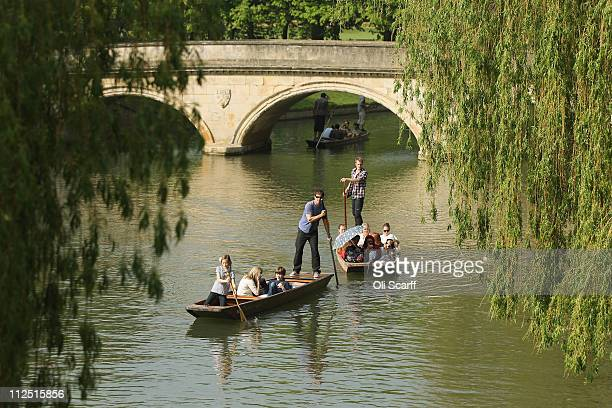 Members of the public punt along the river Cam in front of the colleges of Cambridge University on April 19 2011 in Cambridge England The UK is...