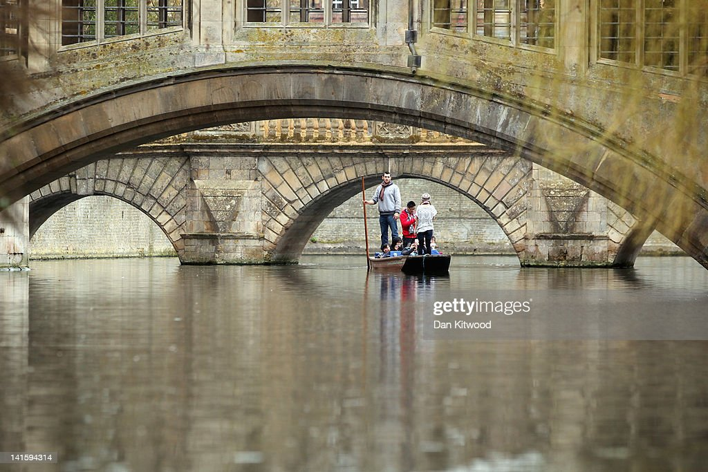 Members of the public punt along the river Cam on March 13, 2012 in Cambridge, England. Cambridge has a student population in excess of 22,000 spread over 31 different independent Colleges across the city. The city is home to several famous University's, including The University of Cambridge, which was founded in 1209, and is ranked one of the top five universities in the world, King's College Chapel, and Trinity College. Famous alumni have included the likes of Charles Darwin, Isaac Newton, Samuel Pepys and David Attenborough.