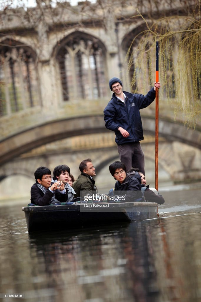 Members of the public punt along the river Cam under the Bridge of Sighs by St Johns college on March 13, 2012 in Cambridge, Cambridgeshire. Cambridge has a student population in excess of 22,000 spread over 31 different independent Colleges across the city. The city is home to several famous University's, including The University of Cambridge, which was founded in 1209, and is ranked one of the top five universities in the world, King's College Chapel, and Trinity College. Famous alumni have included the likes of Charles Darwin, Isaac Newton, Samuel Pepys and David Attenborough.