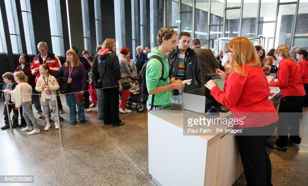 Members of the public queue at the new pound185m Giant's Causeway visitors' centre in County Antrim