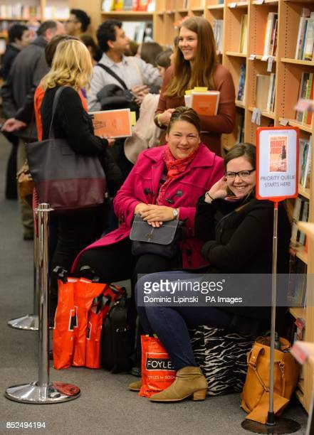 Members of the public queue to get their copies of 'Bridget Jones Mad About the Boy' signed by author Helen Fielding at Foyles in central London