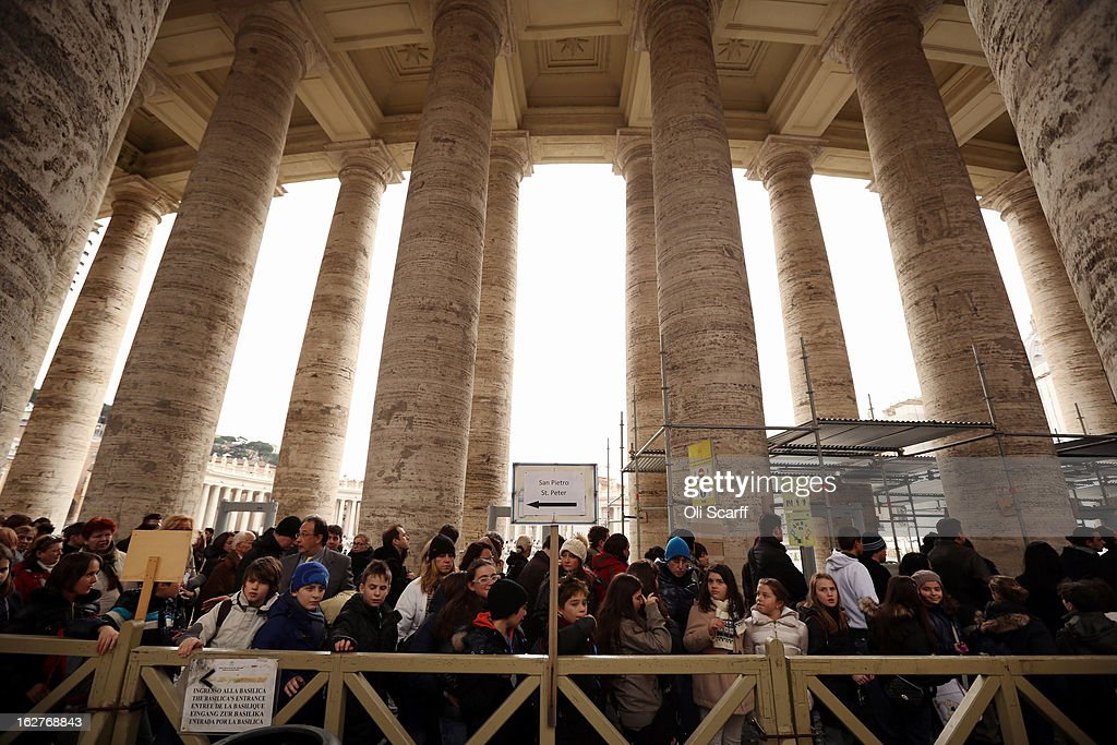 Members of the public queue under the colonnade to enter the Basilica on February 26, 2013 in Vatican City, Vatican. The Pontiff will hold his last weekly public audience on February 27, 2013 before he retires the following day. Pope Benedict XVI has been the leader of the Catholic Church for eight years and is the first Pope to retire since 1415. He cites ailing health as his reason for retirement and will spend the rest of his life in solitude away from public engagements.