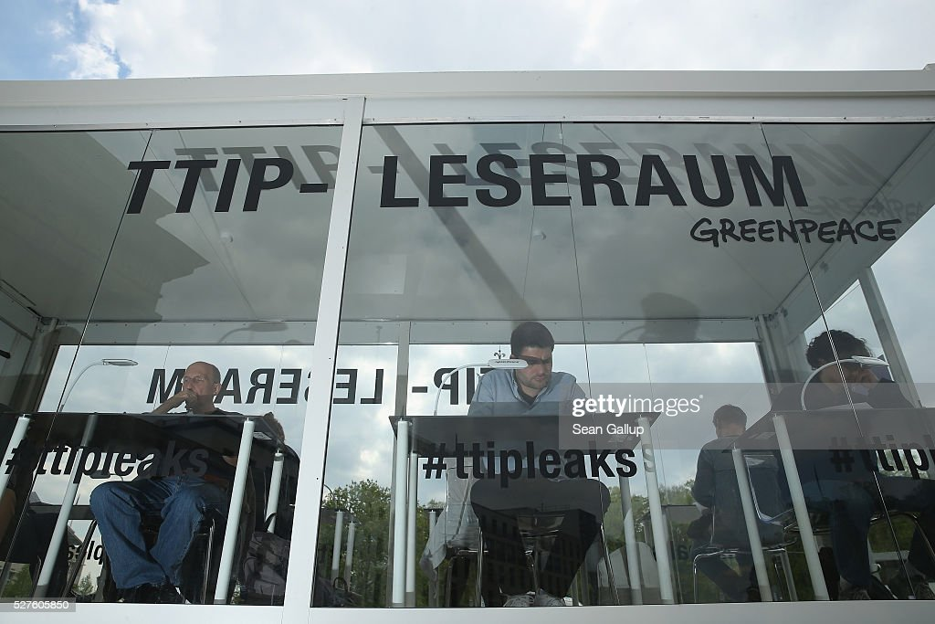Members of the public read copies of documents detailing positions between U.S. and European negotiators over the TTIP trade agreement talks in a Greenpeace mobile reading room next to the Brandenburg Gate on May 3, 2016 in Berlin, Germany. Greenpeace released the documents, which until then had been kept secret by U.S. and European governments, in a press conference yesterday. To many the released documents confirm widespread European fears that TTIP will undermine food safety, consumer rights and the legal system in Europe if implemented.
