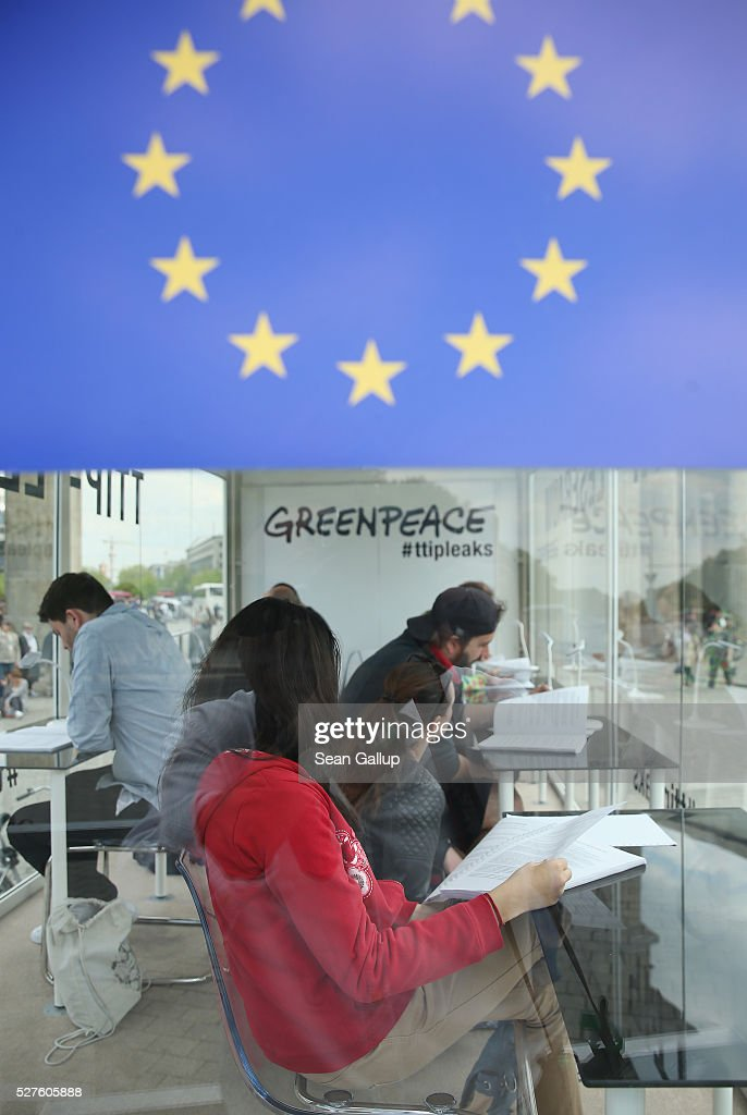Members of the public read copies of documents detailing positions between U.S. and European negotiators over the TTIP trade agreement talks in a Greenpeace mobile reading room adorned with a European Union flag on May 3, 2016 in Berlin, Germany. Greenpeace released the documents, which until then had been kept secret by U.S. and European governments, in a press conference yesterday. To many the released documents confirm widespread European fears that TTIP will undermine food safety, consumer rights and the legal system in Europe if implemented.
