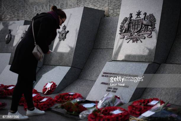 Members of the public read the names of the dead and floral tributes on the Australian War Memorial at Hyde Park Corner following the ANZAC Day dawn...