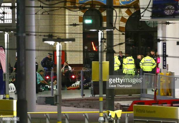 Members of the public receive treatment from emergency service staff at Victoria Railway Station close to the Manchester Arena on May 23 2017 in...