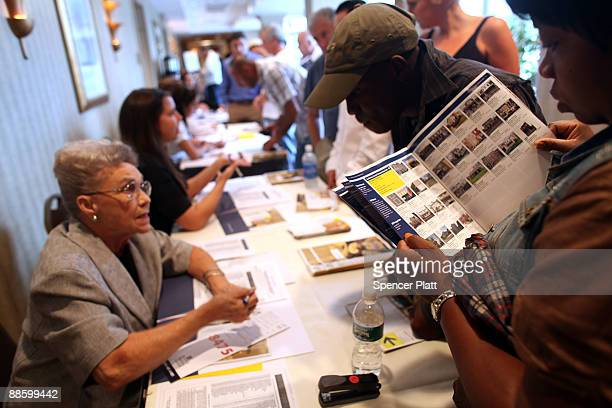 Members of the public register for an auction for more than 25 foreclosed homes at the Renaissance Newark Airport Hotel on June 20 2009 in Elizabeth...