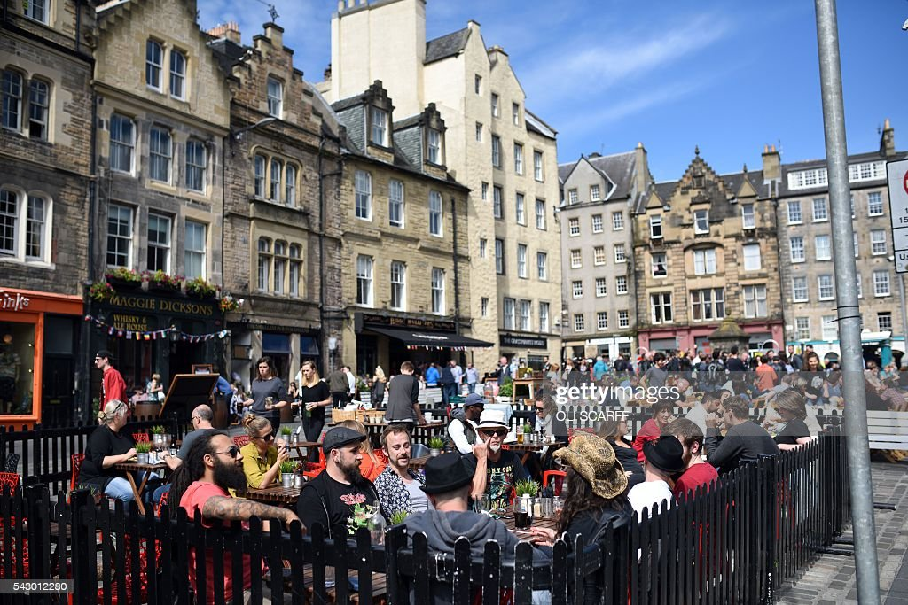 Members of the public relax in cafe's outdoor seating in Edinburgh, Scotland on June 25, 2016. Scotland wants immediate talks with the European Union on protecting its place in the bloc, after Britain's vote to leave the EU, First Minister Nicola Sturgeon said Saturday. Speaking after an emergency meeting of her cabinet, Sturgeon said it had agreed to seek 'immediate discussions with the EU institutions and other EU member states to explore all possible options to protect Scotland's place in the EU.' SCARFF
