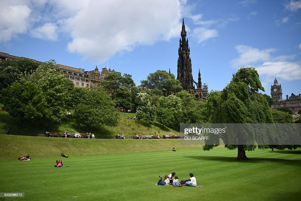 Members of the public relax in Princes Street Gardens in the city centre of Edinburgh, Scotland on June 27, 2016. Britain's historic decision to leave the 28-nation bloc has sent shockwaves through the political and economic fabric of the nation. It has also fuelled fears of a break-up of the United Kingdom with Scotland eyeing a new independence poll, and created turmoil in the opposition Labour party where leader Jeremy Corbyn is battling an all-out revolt. SCARFF