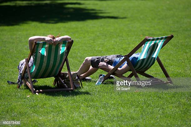 Members of the public relax in St James's Park in warm sunny weather on June 10 2014 in London England Many areas of the UK are experiencing warm...