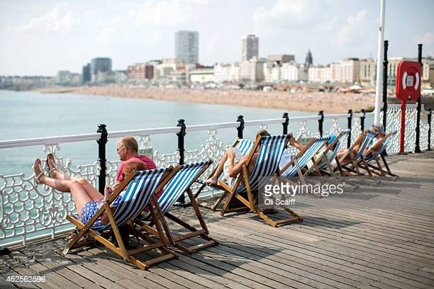 Members of the public relax in the warm weather on Brighton Pier on July 23 2014 in Brighton England The warm weather that large parts of the UK has...
