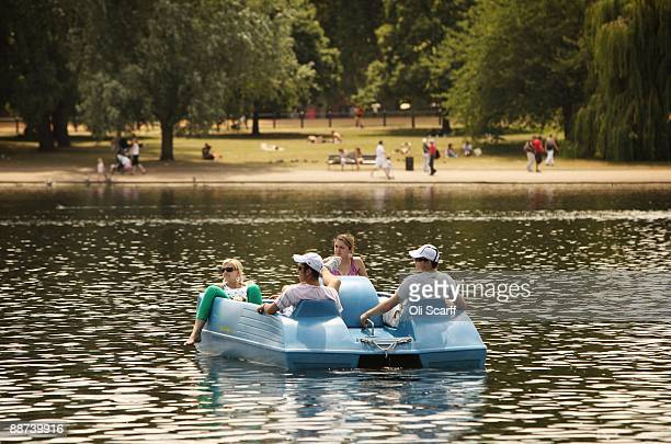 Members of the public ride in a pedalo on Serpentine Lake in Hyde Park on June 29 2009 in London England The Met Office has announced a weather...