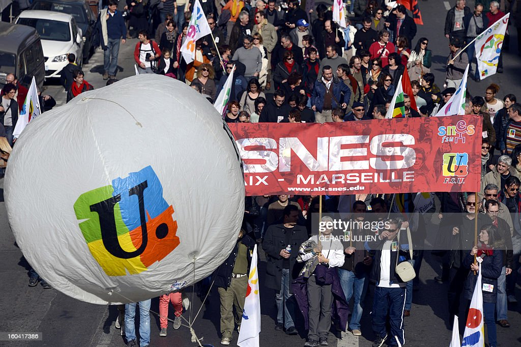 Members of the public sector, (education, health and finance) take part on January 31, 2013 in a national day of protest in Marseille, southern France, against the French government's social policy. For the first time since French President Francois Hollande's election, three labour unions (CGT, FSU, Solidaires) called on 5.2 million civil servants to stop working to show to the government their unhappiness, particularly in terms of purchasing power.