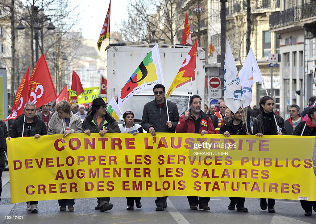 Members of the public sector, (education, health and finance) take part on January 31, 2013 in a national day of protest in Marseille, southern France, against the French government's social policy. For the first time since French President Francois Hollande's election, three labour unions (CGT, FSU, Solidaires) called on 5.2 million civil servants to stop working to show to the government their unhappiness, particularly in terms of purchasing power. Banner reads 'Against austerity. Develop public services. Raise salaries. Create employment statutory.'