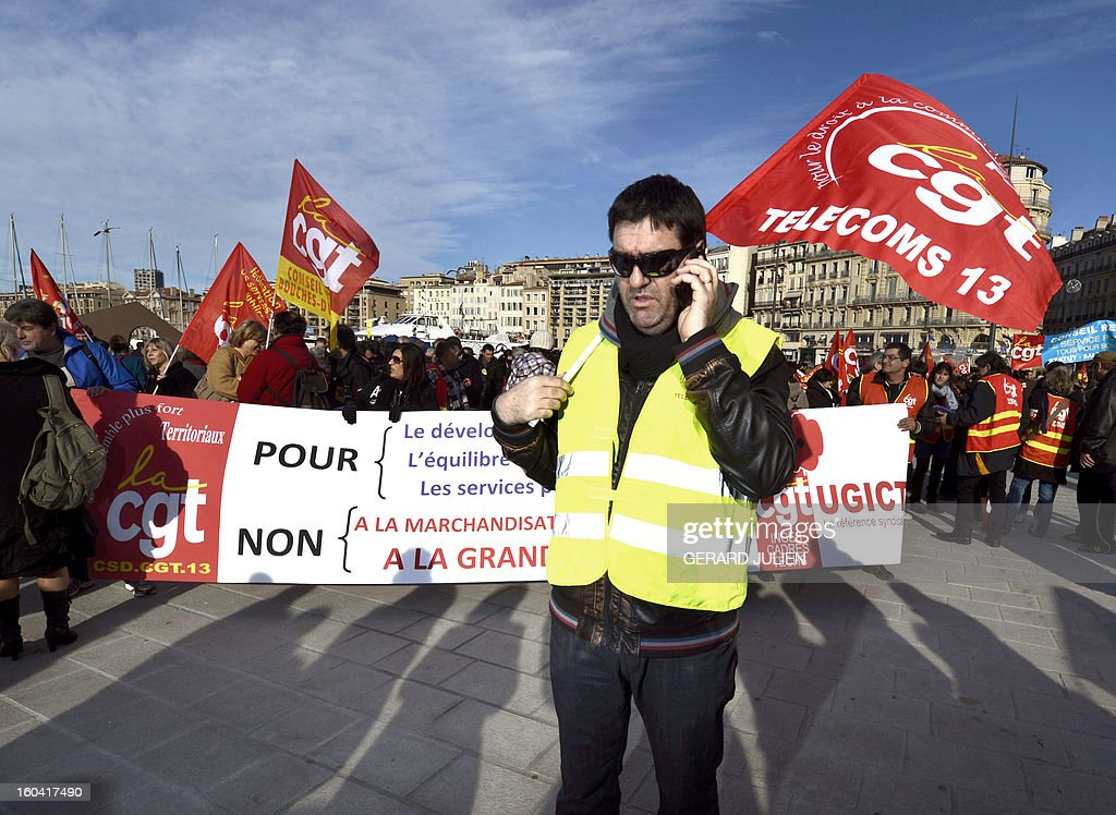 Members of the public sector, (education, health and finance) take part on January 31, 2013 in a national day of protest in Marseille, southern France, against the French government's social policy. For the first time since French President Francois Hollande's election, three labour unions (CGT, FSU, Solidaires) called on 5.2 million civil servants to stop working to show to the government their unhappiness, particularly in terms of purchasing power. Banner reads 'Against austerity. Develop public services. Raise salaries. Create employment statutory.' AFP PHOTO/GERARD JULIEN
