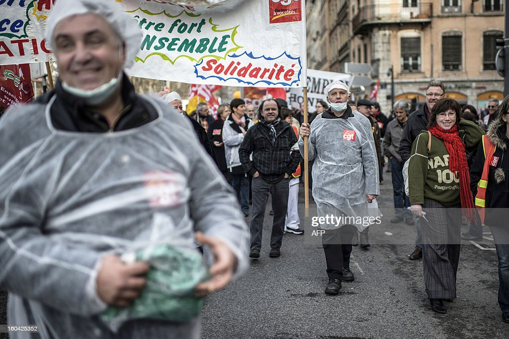 Members of the public sector, (education, health and finance) take part on January 31, 2013 in a national day of protest in Lyon against the French government's social policy. For the first time since French President Francois Hollande's election, three labour unions (CGT, FSU, Solidaires) called on 5.2 million civil servants to stop working to show to the government their unhappiness, particularly in terms of purchasing power. AFP PHOTO / JEFF PACHOUD