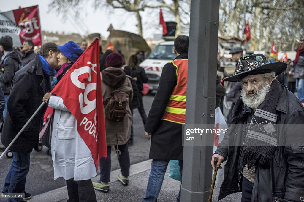 Members of the public sector, (education, health and finance) take part on January 31, 2013 in a national day of protest in Lyon against the French government's social policy. For the first time since French President Francois Hollande's election, three labour unions (CGT, FSU, Solidaires) called on 5.2 million civil servants to stop working to show to the government their unhappiness, particularly in terms of purchasing power.