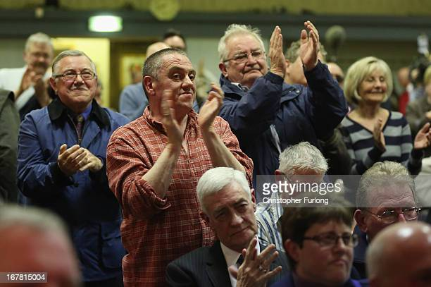 Members of the public stand and applaud as UK Independence Party Leader Nigel Farage addresses members of the public during a political meeting at...