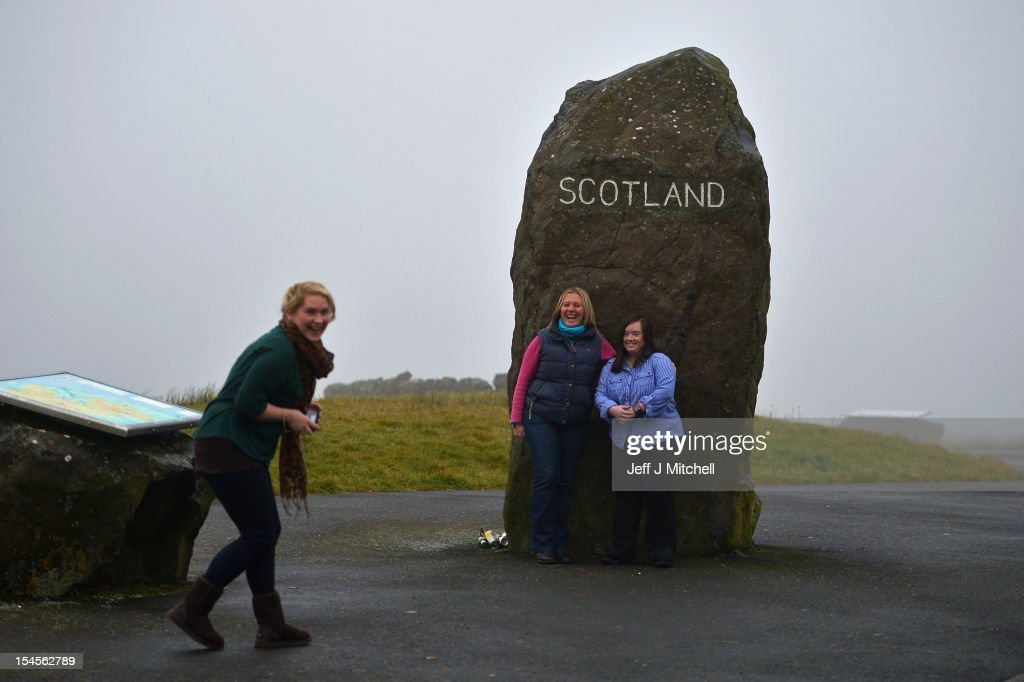 Members of the public stop to take pictures at Carter Bar view point, where the A68 crosses from Scotland into England on October 22, 2012 in Carter Bar, Scotland. Last week Scottish First Minister Alex Salmond met with British Prime Minister David Cameron and agreed on details for a Scottish independence referendum to be held in the autumn of 2014, asking a single yes or no question on whether the country should become independent.