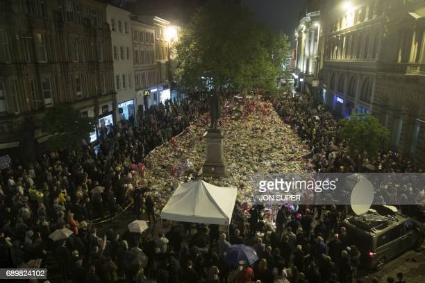 Members of the public take part in a vigil on St Ann's Square in Manchester northwest England on May 29 exactly one week after a bomb attack at...