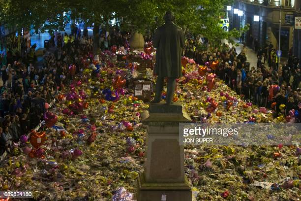 TOPSHOT Members of the public take part in a vigil on St Ann's Square in Manchester northwest England on May 29 exactly one week after a bomb attack...