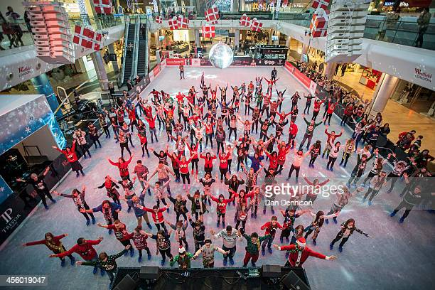 Members of the public take part in an attempt to break the world record for the most people wearing Christmas jumpers on December 13 2013 in London...