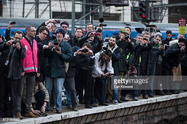 Members of the public take photographs as the Flying Scotsman leaves Kings Cross Station on February 25 2016 in London England The Flying Scotsman...