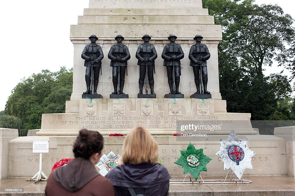 Members of the public take photographs of Battalion wreaths for the (from left) Grenadier, Scots, Welsh, Irish and Coldstream Guards sit at the Guards Memorial ahead of a recruitment day on October 25, 2013 in London, England. The recruitment day sees TA units from the Greater London area getting together for a one-off, interactive experience that will demonstrate their wide-ranging skills and capabilities.