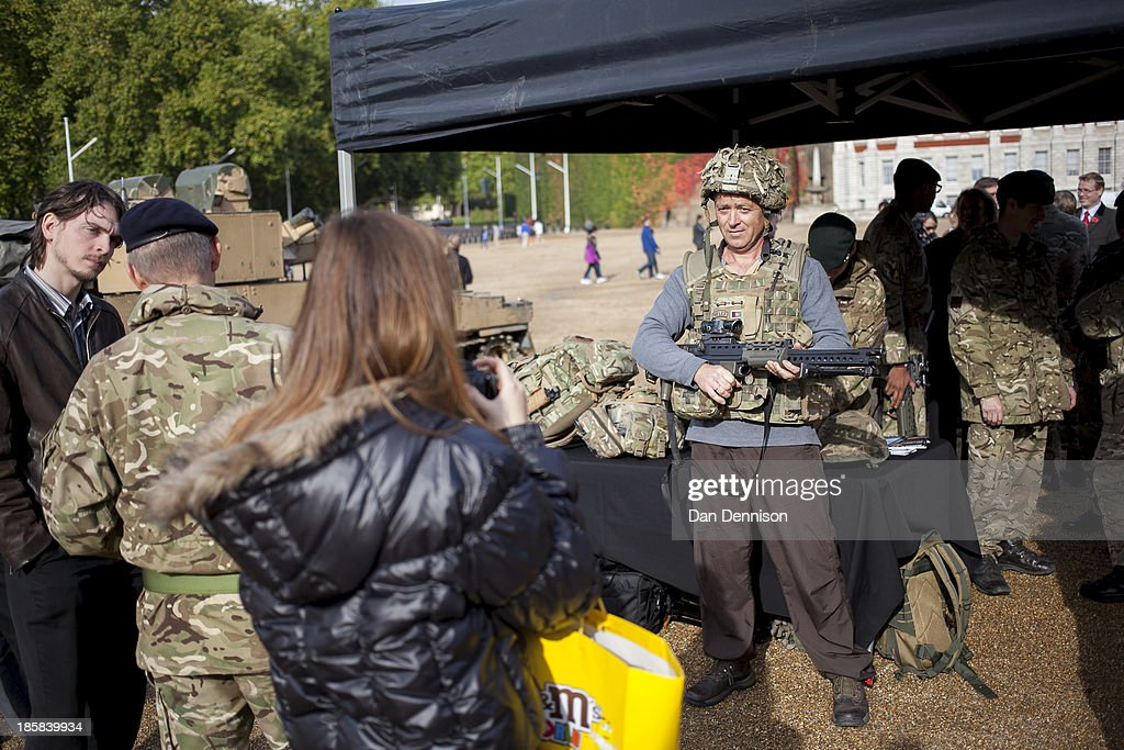 Members of the public try out weaponry and machinery during a Territorial Army recruitment day on October 25, 2013 in London, England. The recruitment day sees TA units from the Greater London area getting together for a one-off, interactive experience that will demonstrate their wide-ranging skills and capabilities.