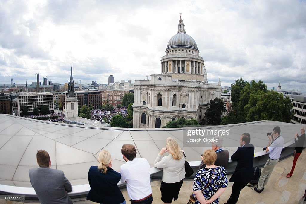 Members of the public turn out on the roof terrace of One New Change shopping centre overlooking St Paul's Cathedral to show support for the British athletes during the parade of Team GB's Olympic and Paralympic athletes on September 10, 2012 in London, England.