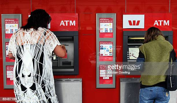 Members of the public use an ATM at a Westpac bank on Collins Street on October 30 2008 in Melbourne Australia Westpac today announced a 6% increase...