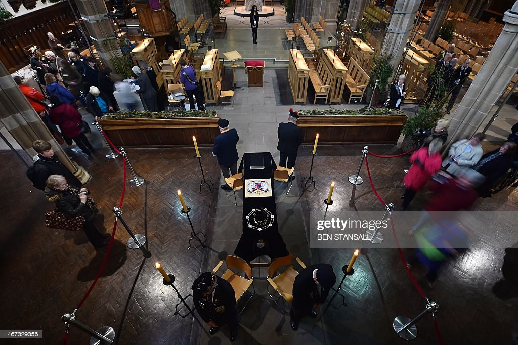 Members of the public view the coffin containing the remains of England's King Richard III in Leicester Cathedral in Leicestershire on March 23, 2015, ahead of a reburial some 530 years on from his violent death in 1485 at the Battle of Bosworth. Tens of thousands lined the streets on Sunday to see the coffin of England's Richard III taken in procession to his final burial, five centuries after his battlefield death.