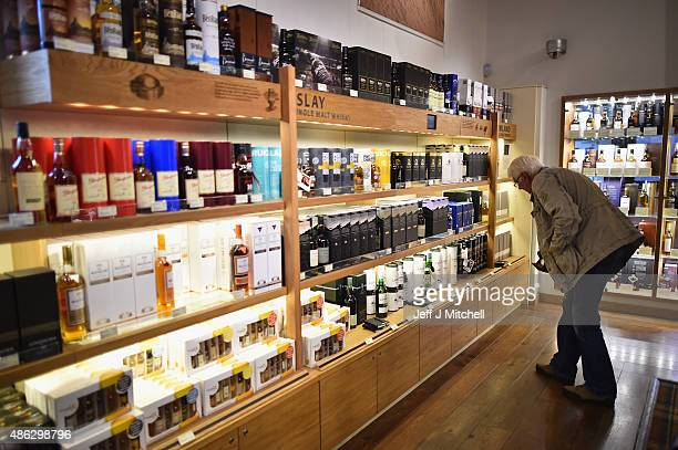 Members of the public view whisky for sale at The Scotch Whisky Experience on September 3 2015 in EdinburghScotlandPlans to introduce a minimum unit...