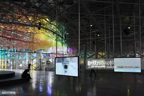 Members of the public visit the 10th SaintEtienne International Design Biennial on March 9 2017 at the SaintEtienne Cite du Design site formerly the...