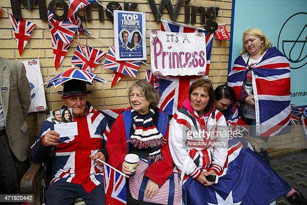 Members of the public wait for the Duchess of Cambridge's birth announcement outside St Mary's Hospital in London England on May 2 2015