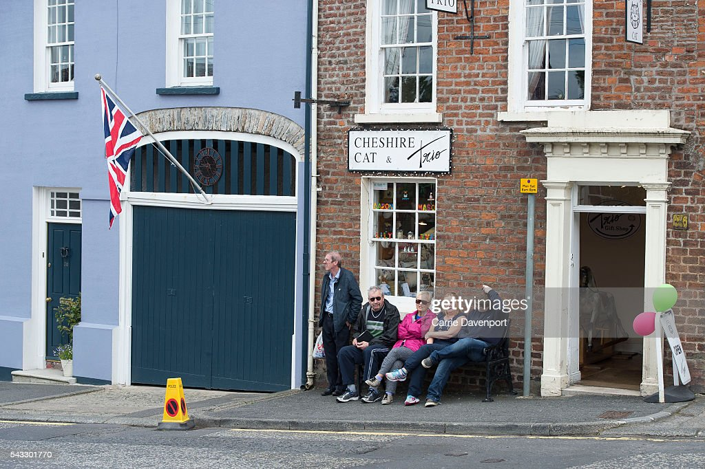 Members of the public wait to catch a glimpse of Queen Elizabeth II and Prince Philip, Duke of Edinburgh as they arrive for a visit to Hillsborough Castle on June 27, 2016 in Belfast, Northern Ireland.