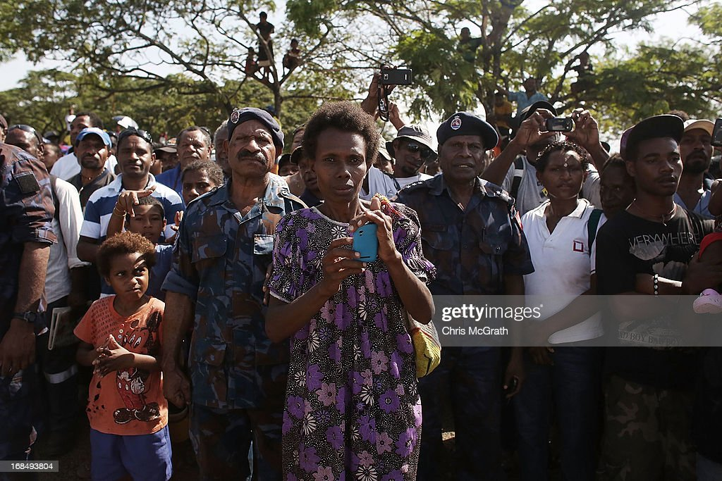 Members of the public wait to see Australian Prime Minister Julia Gillard during her tour of the Gerehu Market on May 10, 2013 in Port Moresby, Papua New Guinea. The three-day visit is a chance for the two nations to strengthen economic ties, with talks being held on key issues including, trade, military defense, and the controversial Australian detention center on Manus Island.The trip is the first official visit for Prime Minister Julia Gillard to the Pacific Island Nation and the first visit since former prime minster Kevin Rudd visited in 2007.