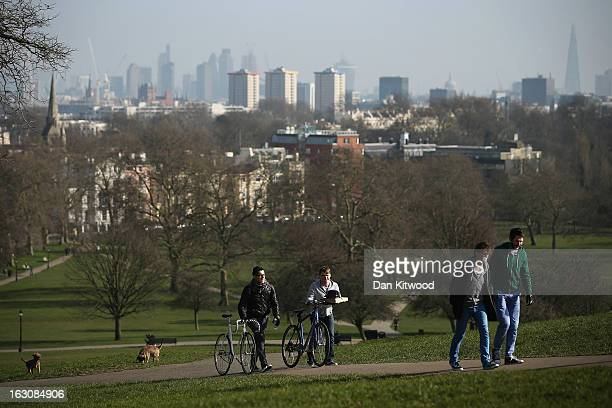 Members of the public walk in the sunshine on Primrose Hill on March 4 2013 in London England The Met office has predicted the warmest day of the...