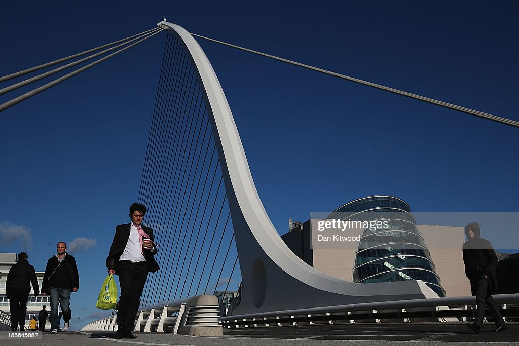 Members of the public walk over the Samuel Beckett Bridge on October 23, 2013 in Dublin, Ireland. The bridge was designed by Santiago Calatrava and opened in 2009. It connects the north and south sides of the River Liffey. Dublin is the capital city of The Republic of Ireland situated in the province of Leinster at the mouth of the River Liffey. The greater Dublin area has a population of around 1.5 Million people.