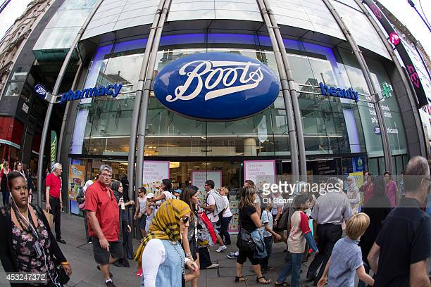 Members of the public walk past a branch of Boots the chemist on Oxford Street on August 6 2014 in London England US pharmacy chain 'Walgreens' who...