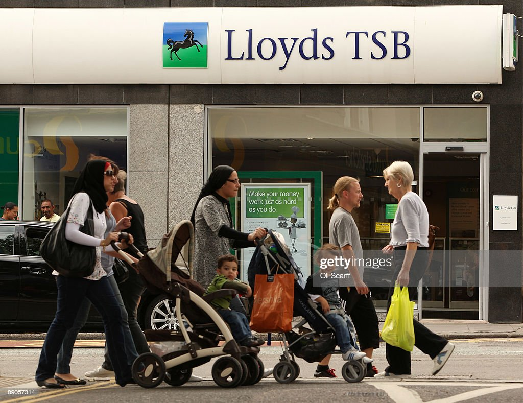 Members of the public walk past a branch of Lloyds TSB bank in Kentish Town on July 16, 2009 in London, England. The Lloyds Banking Group, which is 43% owned by the taxpayer, today announced it is to shed a further 1,200 jobs, bringing the total job losses at the bank in 2009 to 8,200.