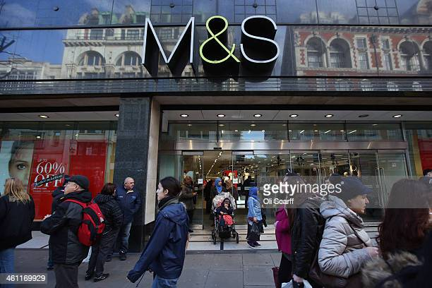 Members of the public walk past a branch of Marks Spencer on January 7 2014 in London England The food and clothing retailer which has traded for 130...