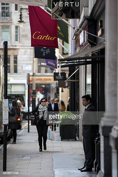 Members of the public walk past luxury goods retailers on Old Bond Street on April 15 2014 in London England A report by property advisers Colliers...