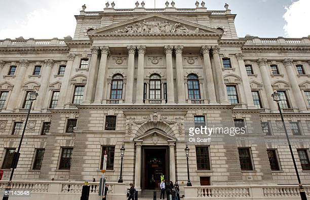 Members of the public walk past of the Government department of 'HM Revenue and Customs' in Westminster on May 8 2009 in London England