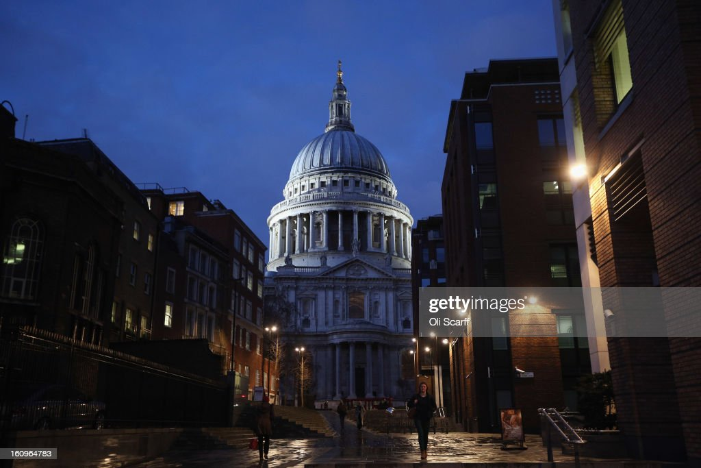 Members of the public walk past St Paul's Cathedral at dusk on February 8, 2013 in London, England.